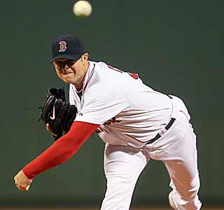 Jon Lester does what he can by throwing seven strong innings to help Boston defeat New York. (Getty Images)