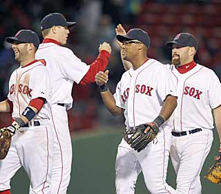Dustin Pedroia (left) leads the Red Sox celebration after finishing with two hits and two RBI. (AP)