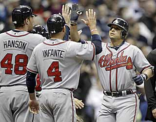 Martin Prado (right) has a lot of people to high-five at home after clearing the bases with a grand slam. (AP)