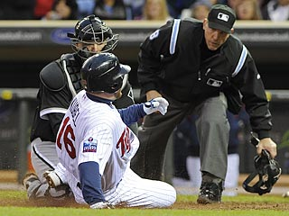 Umpire Jeff Kellogg makes sure A.J. Pierzynski has the ball before calling Jason Kubel out in the fourth.  (AP)