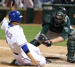 The A's cut down pinch-runner Andres Blanco at home in the 12th inning to preserve the tie.  (US Presswire)