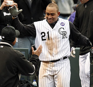 One of Miguel Olivo's five hits on the afternoon is a game-winning home run in the 10th.  (AP)