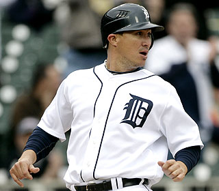 Magglio Ordonez drives in one of Detroit's runs in the first game of a doubleheader against the Yankees. (AP)