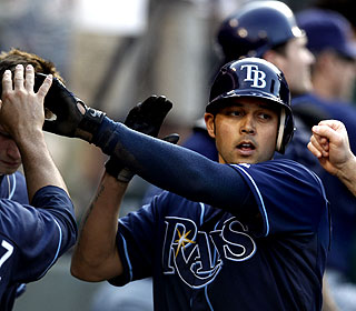 Rays' Jason Bartlett scores on one of the Ryan Budde passed balls in the fifth inning. (AP)