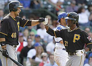 Andrew McCutchen (22) and Garrett Jones (46) go a collective 10 for 11 and each drills a homer. (AP)