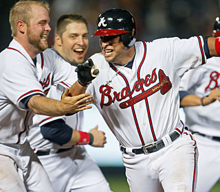 Martin Prado is the center of attention after driving in the winning run in the ninth.   (AP)