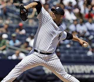Andy Pettitte pitches 6 1/3 innings of two-hit ball and improves to 5-0 this season. (AP)
