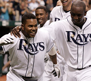 Willy Aybar (left) ends the afternoon on a good note for Tampa Bay with his walk-off shot.  (US Presswire)