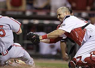 Ramon Hernandez applies the tag at home on the Cards' Skip Schumaker for the final out of the game. (AP)