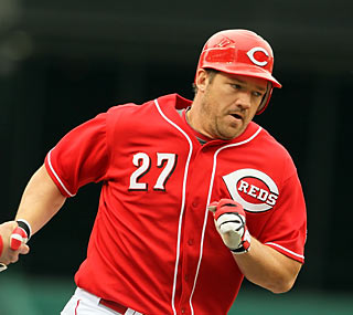 Scott Rolen hits a home run and drives in three for the first-place Reds.  (Getty Images)