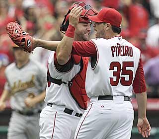 Joel Pineiro is congratulated by batterymate Mike Napoli after tossing his sixth career shutout. (AP)