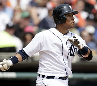 Ramon Santiago hits a two-run shot as the Tigers plow through 2009 playoff teams.  (AP)