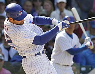 Xavier Nady comes up with a big pinch-hit RBI single to help the Cubs get their first win over the Pirates. (AP)