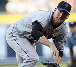 Although historically a bad month for Mike Pelfrey, he becomes the first Mets' starter to get a win in May. (AP)