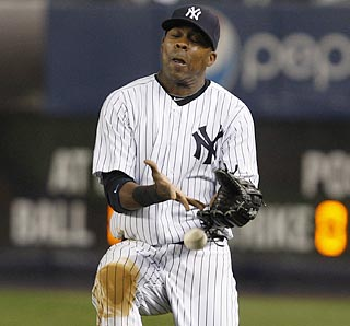 A hero the night before, Marcus Thames becomes a goat when he drops a fly ball in the ninth inning. (AP)