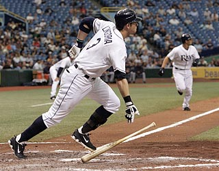 Jason Bartlett (right) watches Evan Longoria's two-run triple to center while heading for home.  (US Presswire)