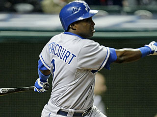 Yuniesky Betancourt drives in three runs off Kerry Wood in the ninth inning. (AP)