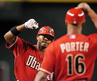 Justin Upton helps keep Arizona third-base coach Bo Porter busy giving home-run high-fives.  (US Presswire)