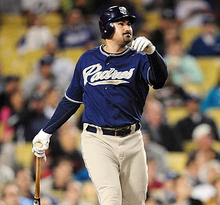 Half of Adrian Gonzalez's six RBI comes on this mighty swing in San Diego's five-run fourth inning.  (US Presswire)