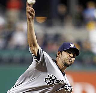 Carlos Villanueva becomes the first pitcher other than Trevor Hoffman to save a game for the Brewers. (AP)