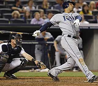 Carlos Pena admires his second long ball of the game, and Tampa Bay's fourth of the night.  (AP)
