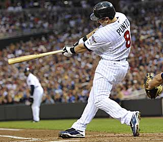 Nick Punto smacks an RBI double in the first as the Twins tee off against Dave Bush and the Brewers. (AP)