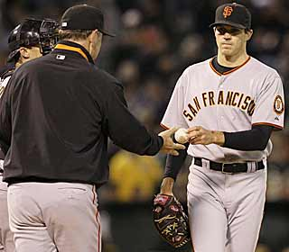 Despite coming in with a 0.89 ERA on the road this season, Barry Zito gives up six runs to his old team. (AP)