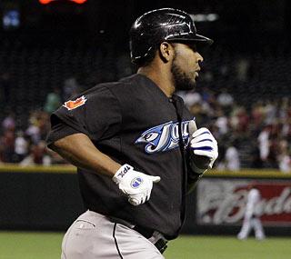 Edwin Encarnacion slams three of Toronto's six home runs, but the Jays still fall in Arizona.  (AP)