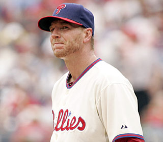 Roy Halladay has no answers for the Red Sox, allowing eight hits and six earned runs.  (AP)