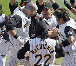 Ryan Doumit gets a hero's welcome after his two-out, game-ending homer in the 10th.  (AP)
