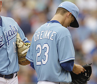 Reigning AL Cy Young winner Zack Greinke falls to 1-5 after allowing seven earned runs in 3 1/3.  (AP)