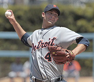 Rick Porcello shakes off three comebackers to go six innings and even his record.  (AP)