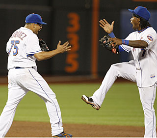 Francisco Rodriguez and Jose Reyes celebrate after the Mets escape a ninth-inning jam.  (AP)