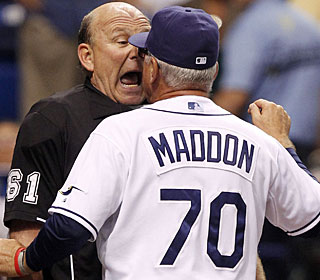 Rays manager Joe Maddon confronts umpire Bob Davidson even after being ejected from the game. (AP)
