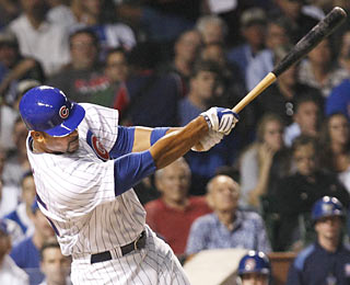 Derrek Lee gives the Cubs' pitching staff a major boost by driving in all the runs, including a two-run shot.  (AP)