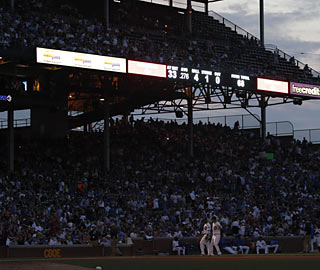 A nearby fire causes a power outage in the fourth inning, which forces an 18-minute game delay at Wrigley.  (AP)