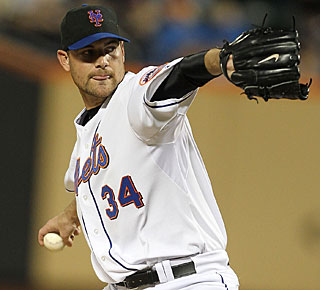 Mike Pelfrey shows his stuff to complete a superb pitching feat by the New York Mets. (Getty Images)
