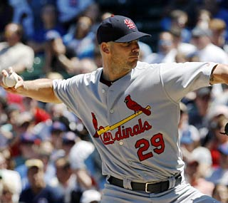 Chris Carpenter gets the job done in 6 2/3 innings with a big assist from the Cardinals offense.  (AP)