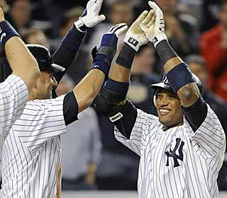 Robinson Cano gets a high-five from the captain after smacking a grand slam in the seventh. (AP)