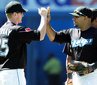 Lyle Overbay's two dingers end an 0-for-17 rut while Vernon Wells (right) hits his second in a row. (AP)
