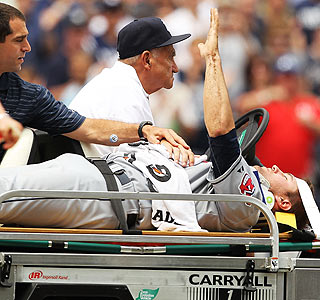 Pitcher David Huff signals he's OK after getting hit in the head by an Alex Rodriguez line drive.  (Getty Images)