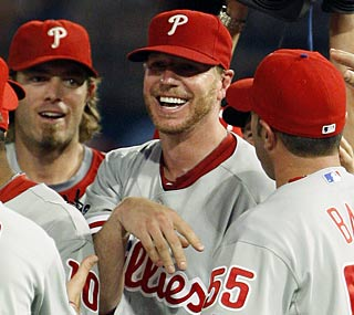 The usually stoic Roy Halladay lets loose a bright smile after his historic perfect game.  (AP)