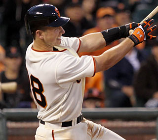 Buster Posey, a top prospect for the Giants, knocks three hits and three RBI in his season debut.  (Getty Images)