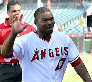 Howie Kendrick and the Angels make sure no one gets injured during this celebration.  (Getty Images)