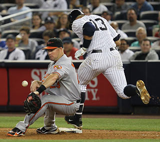 Miguel Tejada's poor throw to first costs the O's as two runs score with two outs in the seventh.  (Getty Images)