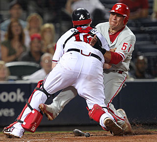 Braves catcher Brian McCann tags out Carlos Ruiz, who tries to score on a ground ball in the seventh. (AP)