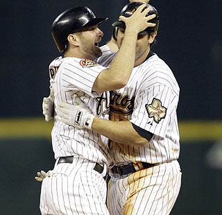 Jeff Keppinger and Lance Berkman celebrate after Berkman's single helps the Astros defeat the Nats.  (AP)