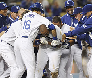 No injuries here, just a good headlock as Matt Kemp is greeted at home plate by his teammates. (AP)
