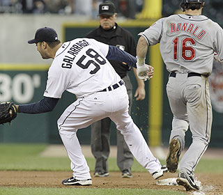 It's a close call at first base as Armando Galarraga gets the throw from Miguel Cabrera.