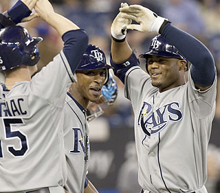 Carl Crawford greets Scott Downs in the ninth inning by hitting his third career grand slam. (AP)